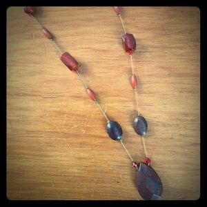 Gold and orange/red beaded necklace